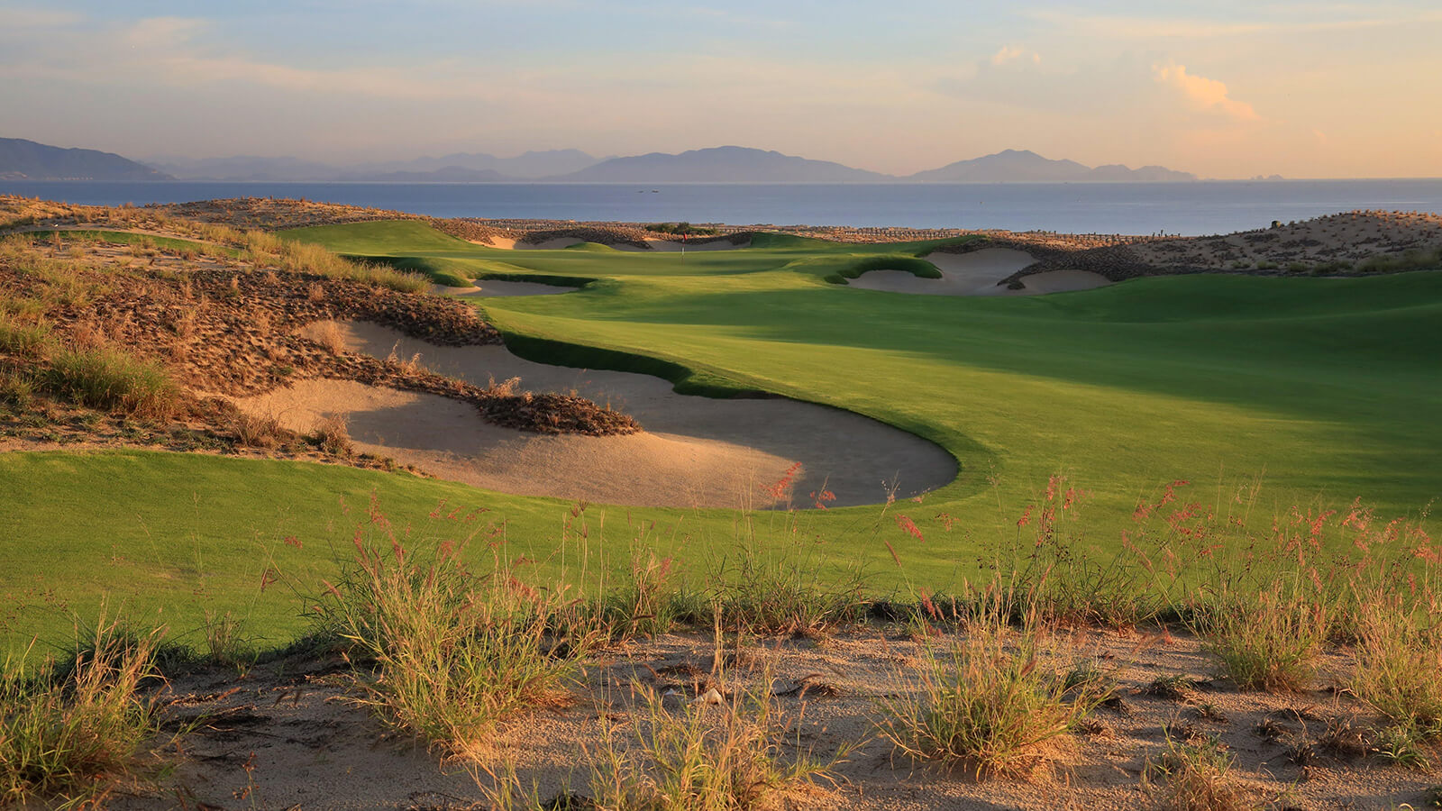 The 18th hole at KN Golf Links Cam Ranh offers stunning views of the ocean